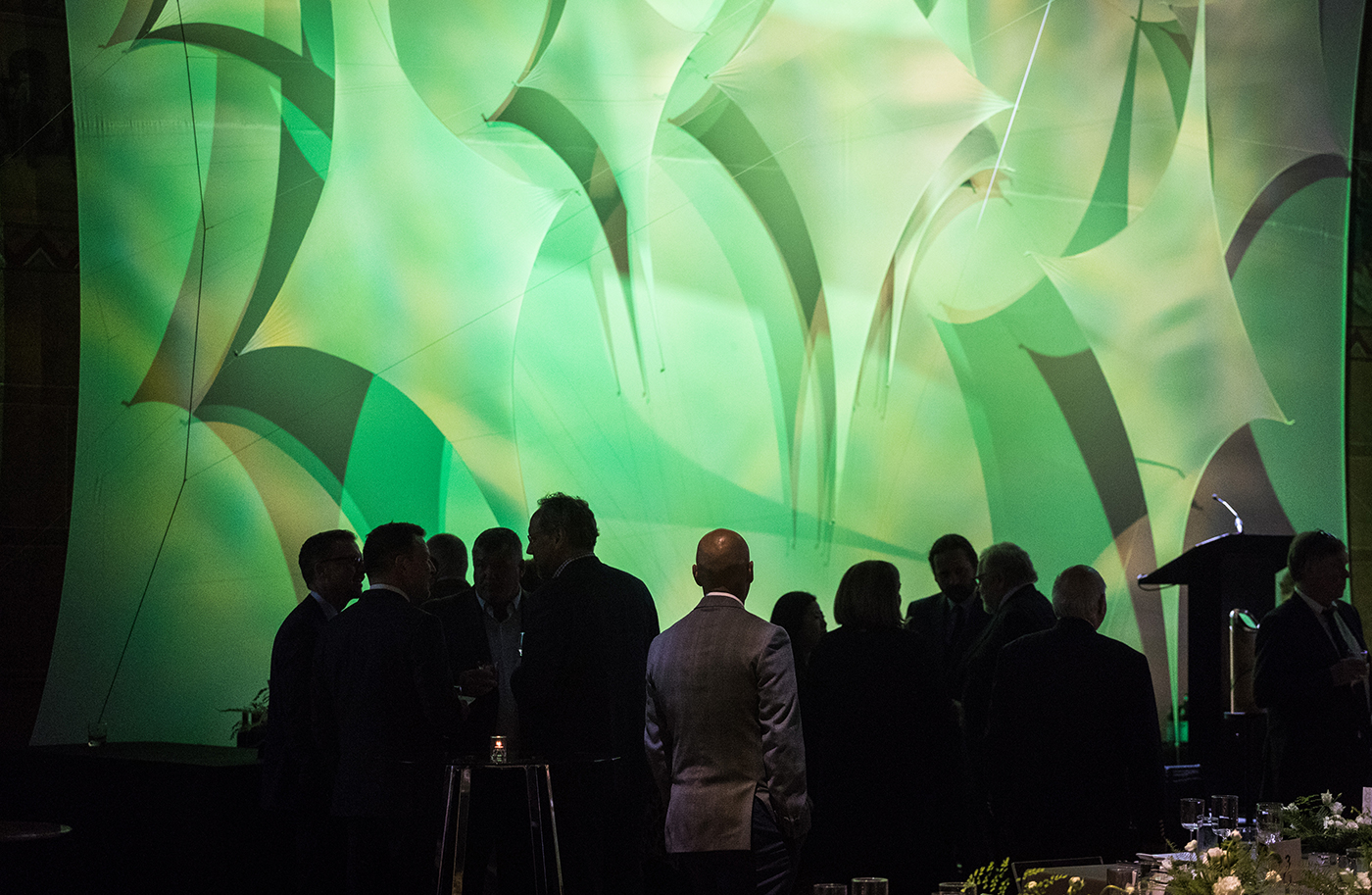 Attendees mingle in front of custom large-scale graphics