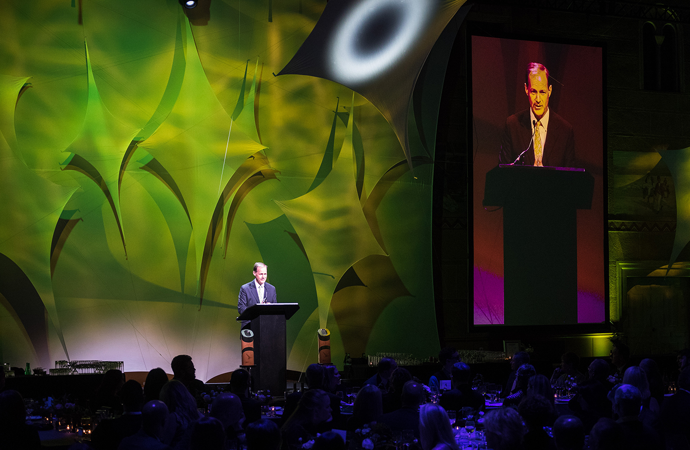 Pioneer awards flanking podium and speaker